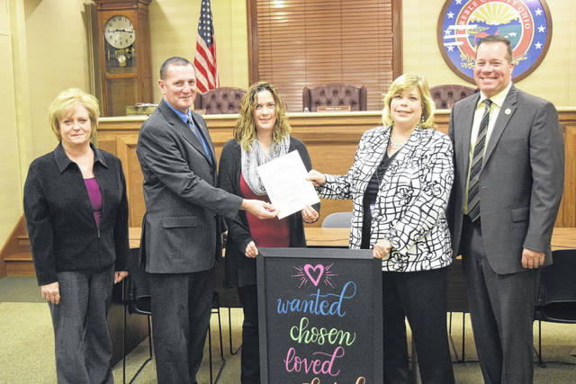 The day of celebration opened with the Preble County Commissioners presenting Becky Sorrell with a proclamation declaring November as National Adoption Month. Following the recognition, Sorrell headed upstairs to watch the three different adoption proceedings.