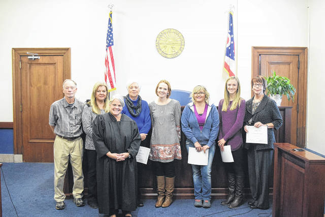 There are six new court-appointed special advocates for abused and neglected children, called simply CASA volunteers. They were sworn in by Judge Jenifer K. Overmyer on Wednesday, Nov. 22