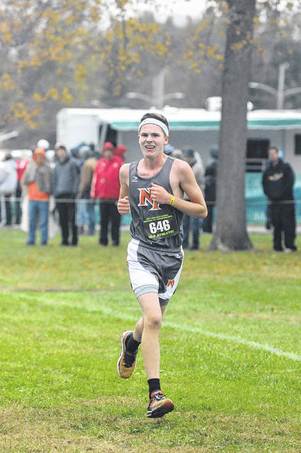 National Trail's Caleb VanWinkle approaches the finish line during the Division III regional cross county meet on Saturday, Oct. 28. VanWinkle placed 66th to help the Blazers to a seventh place finish.