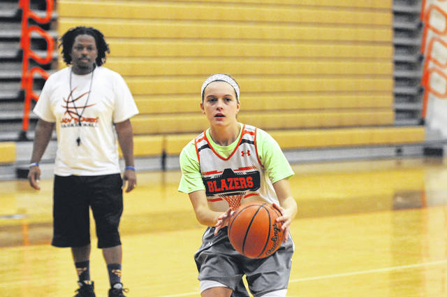 National Trail girls' basketball coach Michael Paige looks on as junior Evan Byrd runs a play during practice last week. The Blazers are looking to improve on its 10-win season from a year ago.