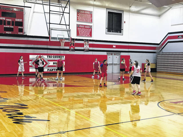 Tri-County North's girls' basketball team runs through drills during practice last week. The Panthers are looking to have a winning record this season.