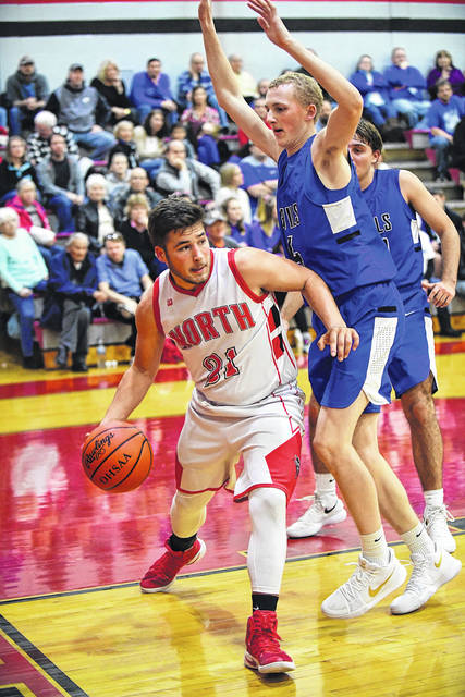 Tri-County North's Josh Heindl looks to pass to a teammate during the Panthers game with visiting Brookville on Friday, Dec. 15. North jumped out to an early double-digit lead and cruised to a 58-42 win.