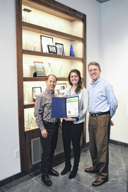 Henny Penny Corporation was selected by Secretary of State Jon Husted as one of January's featured businesses for the Ohio Business Profile Program. Beth Hammond, a representative from the Secretary of State's office, visited the company on Monday, Jan. 22, to present Alex Morgan, Vice-President of Brand, and Jeff Frymier, Director of Corporate Relations, with a certificate highlighting this accomplishment.
