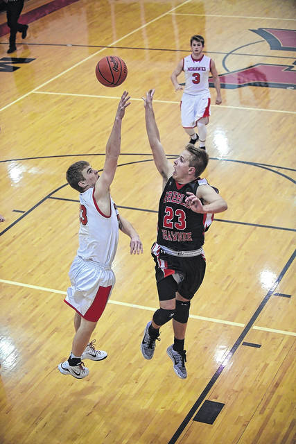 Preble Shawnee's Joey Bates puts up a shot during the Arrows SWBL contest at Madison on Saturday, Jan. 6. Bates scored five points and had seven rebounds, but Shawnee shot just 24 percent from the field and suffered its first league loss, 41-32.