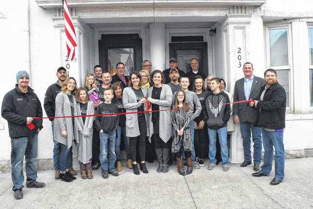 Two new businesses have found their homes in the Village of Lewisburg. Located in a beautifully restored duplex, Livin' on Dreams Boutique and Paisley Perfect Photography by Mandy Studio held their ribbon cutting ceremony and open house on Saturday, Feb. 17.