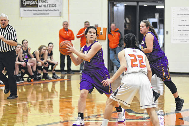 Eaton's Emily Dungan looks to pass to a teammate while being guarded by National Trail's Evan Byrd during a non-league game on Saturday, Feb. 10. Eaton got off to a quick start, leading 20-5 after the first quarter, and rolled to a 57-38 win.