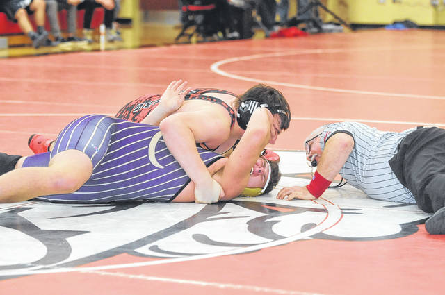 Preble Shawnee's Ty Stevenson pins Eaton's Tyler Schmidt during a semifinal match on Saturday, Feb. 17, during the Southwestern Buckeye League wrestling tournament. Stevenson won the 220 pound weight class to help the Arrows to a runner-up finish in the Buckeye Division for a second straight year.