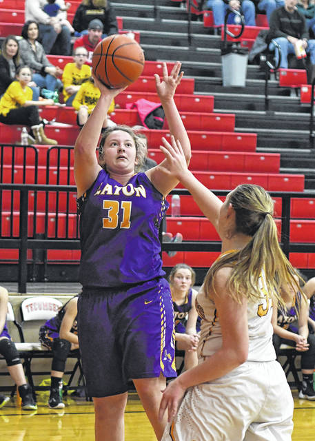 Eaton junior Becca Mowen puts up a shot in the second half of the Eagles first round tournament game on Saturday, Feb. 17. Eaton fell to No. 3 seed Springfield Shawnee, 39-25, in the opening round of the Division II sectional at Tecumseh High School.