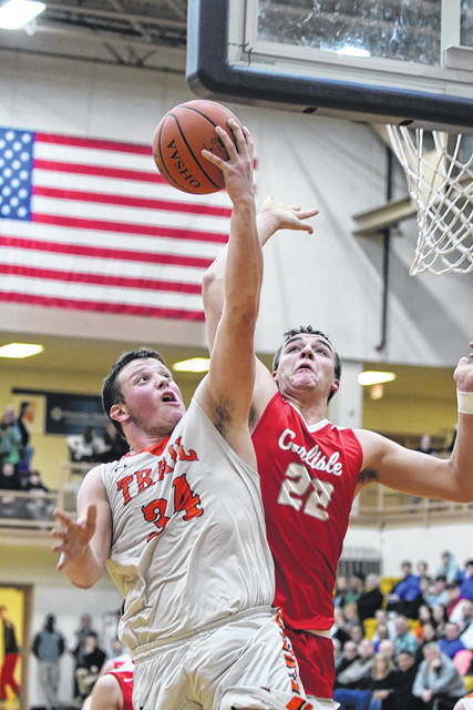 National Trail's Dalton Mason is fouled going for a layup during the second half of the Blazers sectional tournament game on Saturday, Feb. 24. Mason, along with Cameron Harrison and Zach Woodall each scored 15 points in the Blazers 58-46 win over Carlisle.