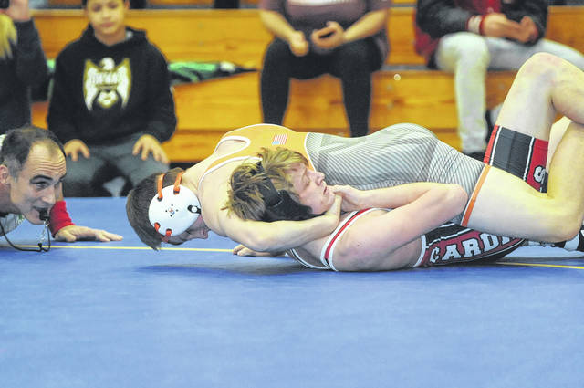 National Trail's Peyton Lane pins Dylan Hollar of Triad in a second round match during the Division III sectional at Lehman Catholic High School on Friday, Feb. 23. Lane won the 132-pound division and improved his record to 28-1.
