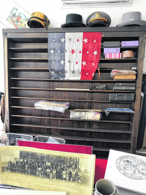 The Village of Lewisburg is working to raise money for the upcoming Bicentennial Celebration. The main way the committee raises these funds is by selling merchandise from their Bicentennial Storefront. Not only can one find many different items for sale, but there are also historical items and documents on display.
