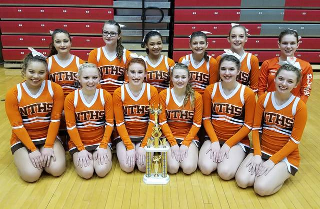 "Despite a late start and not having as much experience as other teams, the National Trail Cheerleading squad placed eighth at the Division 5 State Competition. Coach Roxanne Laird said, ""We do not have any seniors, so this was our building year and we are more than ready to come back stronger and better next year."""