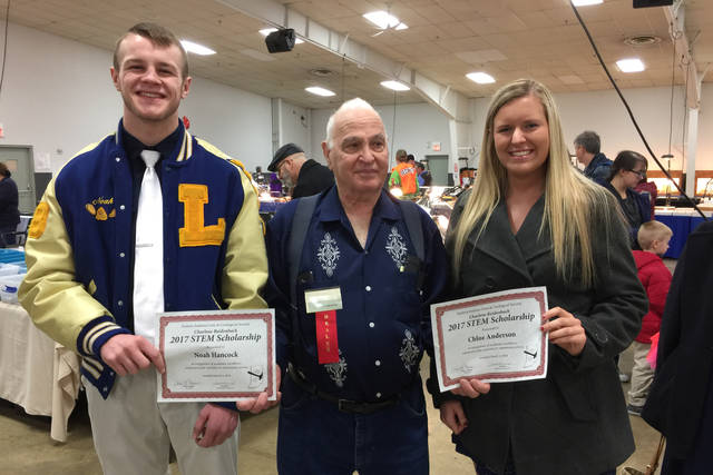 On behalf of the Eastern Indiana Gem & Geological Society, club member John LaMont presents the 2018 Charlene Reidenbach STEM Scholarships to Noah Hancock (Lincoln HS) and Chloe Anderson (National Trail HS). The award was presented at the Richmond Gem and Mineral Show, March 4.