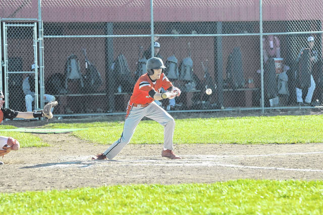Tri-County North's Collin Whipp puts down a bunt during the Panthers game at Preble Shawnee on Friday, April 20. North rallied for an 11-8 win.