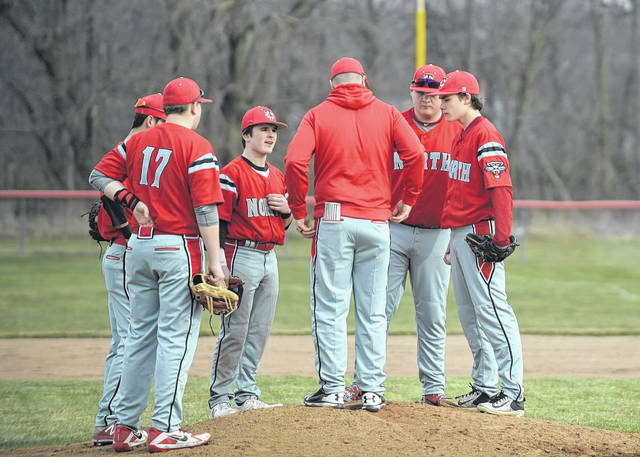 Tri-County North coach Justin Tucker talks to his team during the a game with Mississinawa Valley on Monday, March 26. North fell to the Blackhawks, 8-0, but bounced back with a pair of wins over Valley View, 10-8 and 9-3 on Saturday, March 31.