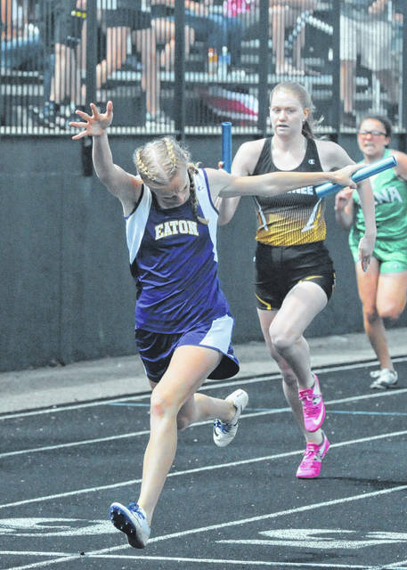 Eaton's Makenzi Cooper crosses the finish line to help the Eagles win the 4x200-meter relay at the Graham Division II District meet on Saturday, May 19.