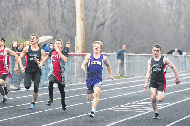 Eaton's Tyler Gregory, second from right, leads the field in the 100-meter dash during the Preble County meet on Tuesday, April 24. Also pictured, left to right, Chase Thompson (Preble Shawnee), Kyler Kohl (Twin Valley South) and Austin Fields (Preble Shawnee).
