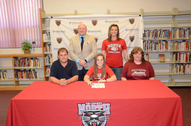 Tri-County North's Megan Poling (middle front) recently signed to play college basketball at Muskingum University.