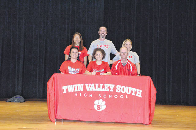 Twin Valley South's Mylan Crews (front middle) recently signed with St. Francis (PA.) University to be a member of the track and field team.