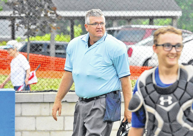 Kevin Forrer works as the home plate umpire during an ACME tournament game between Miami East and Piqua Thursday at Miami East High School. Forrer, the official assignor for the GWOC, says that the Southwest District is trying to add 75 new football officials with a variety of officiating classes available throughout the area before the season begins in the fall.