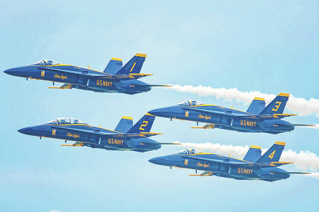 """U.S. Navy Blue Angels in their """"diamond"""" formation as they pass by the crowd at the 2018 Dayton Air Show presented by Vectren."""