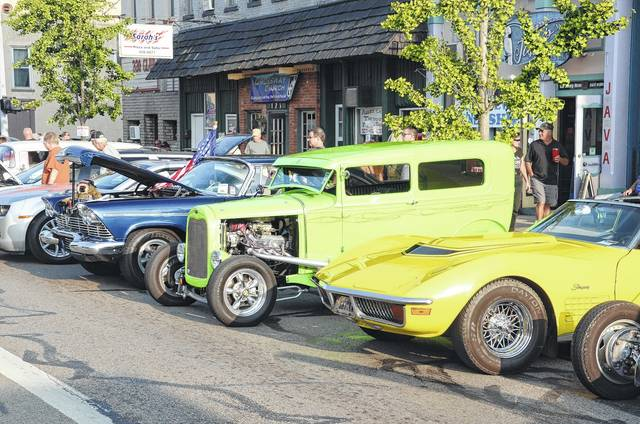 """Over 400 cars turned out for the 2017 Old Fashioned Downtown Saturday Night event in Eaton. Sponsored by Downtown Eaton Inc., Eaton Police Association and Eaton Fire and EMS Association, the event helps close out the last weekend in August with a wide variety of vintage and """"souped up"""" vehicles and motorcycles, good food, live music and family fun, as well door prizes and more for those who entered the car show."""