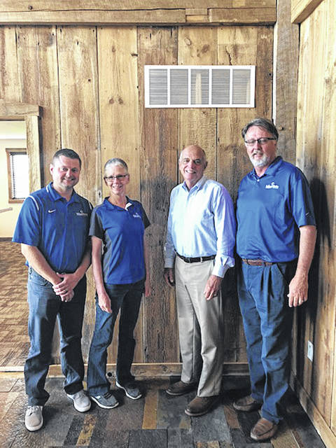 Edison State administrators Chad Beanblossom, Vice President of Regional Campuses, Dr. Doreen Larson, President, and Tom Milligan, Board of Trustees Chairman meet with Bill Dues, President of the Preble County Youth Foundation.