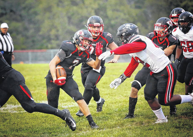 Preble Shawnee's James Gibson looks for running room during the Arrows game with visiting West Carrollton on Friday, Sept. 7. The Arrows came up short as the Pirates scored late to pull of the win, 47-42.