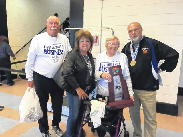 Von Moreland, far right, is pictured with his older brother, Doug, sister Cindy and mom Cynthia after his team won the Florida Class 1A boys basketball state championship. His brother, Tony, is not pictured.